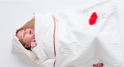 When do babies start turning on their stomach or on their side?